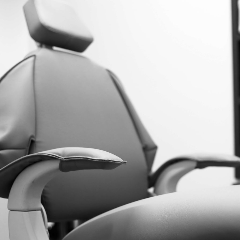 black and white dentist chair thumbnail